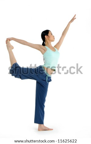 Young asian doing yoga in the  room - stock photo