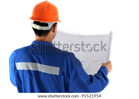 young asian engineer with construction drawing in oil and gas industry concept - stock photo