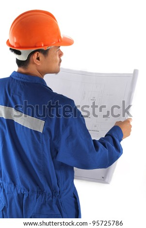 young asian engineer with coverall and drawings standing isolated on white background - stock photo