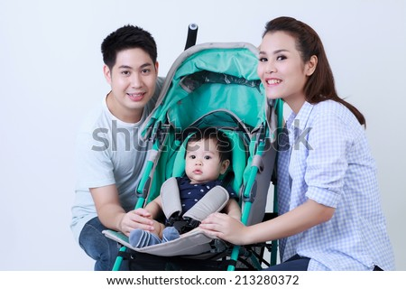 Young asian family and son in the pram smile happily isolated - stock photo