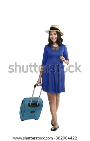 Young asian female tourist isolated over white background