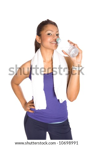 Young Asian fitness trainer drinking bottled water after her exercise, isolated.