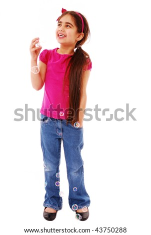 Young asian girl blowing bubbles isolated on white