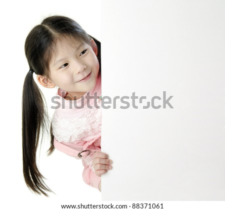 Young Asian girl holding a blank white card. - stock photo