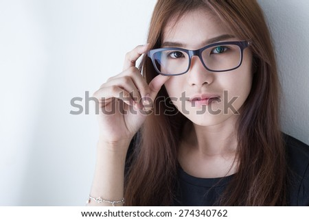 Young Asian girl in serious style - stock photo