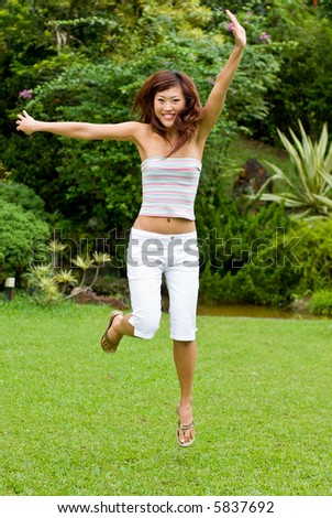 Young asian girl outdoors enjoying herself