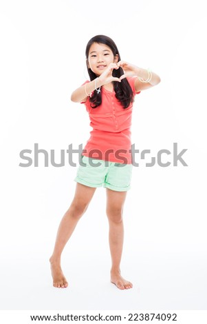 Young Asian girl showing heart shape isolated on white.  - stock photo
