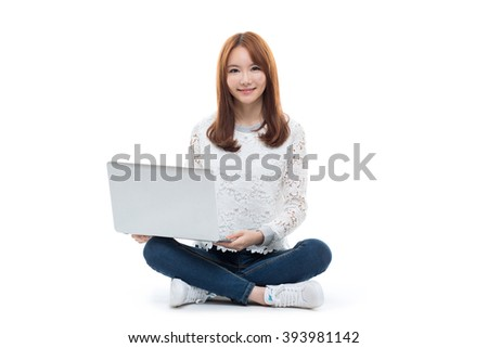 Young asian girl sitting on the floor with laptop isolated on white background. - stock photo