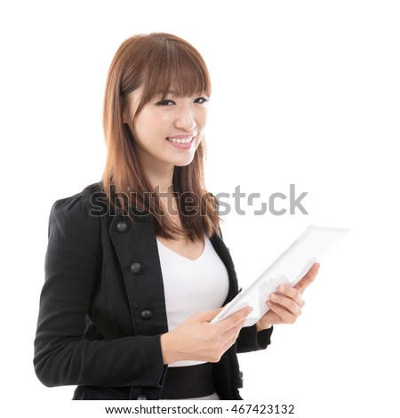 Young Asian girl using digital computer pad, isolated on white background.