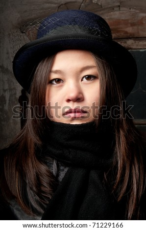 Young asian girl wearing vintage hat