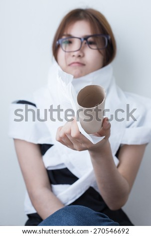 Young asian girl with toilet paper and white background
