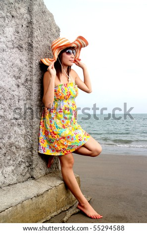young asian lady enjoying the beach view
