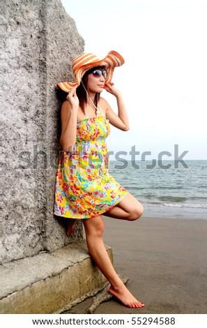 young asian lady enjoying the beach view - stock photo