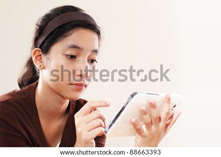Young asian lady with computer tablet - stock photo
