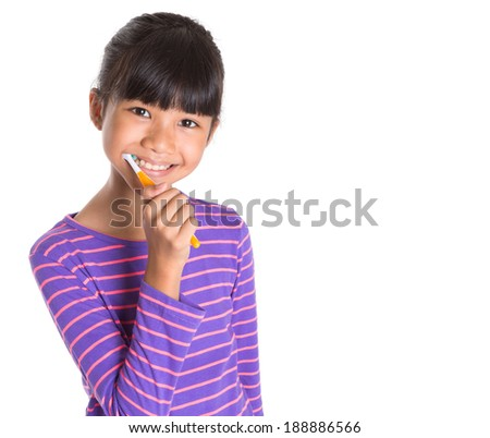 Young Asian Malay girl with toothbrush over white background
