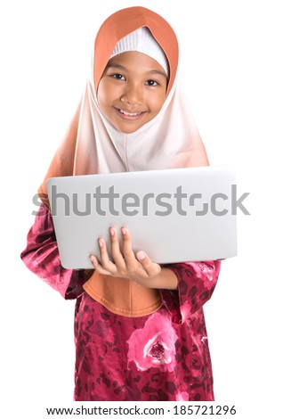 Young Asian Malay Muslim girl in modern hijab with a laptop over white background - stock photo