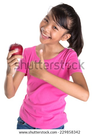 Young Asian Malay teen showing a thumbs up sign with a red apple over white background - stock photo