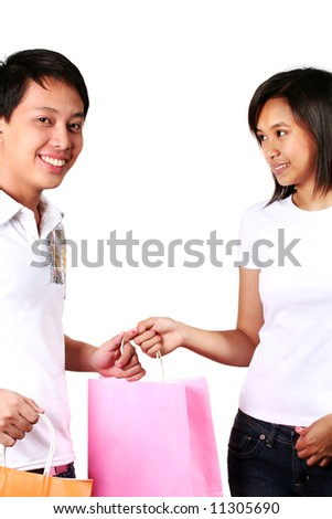 Young Asian Male and Female with Shopping Bags