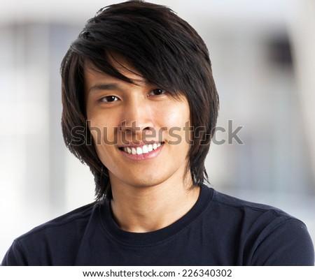 Young asian man close up shot - stock photo