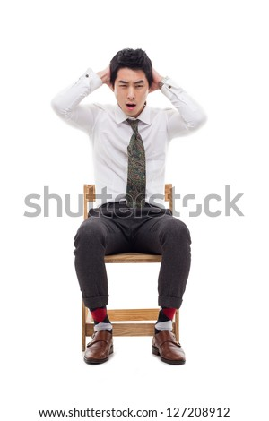 Young Asian man having a stress on isolated on white background. - stock photo