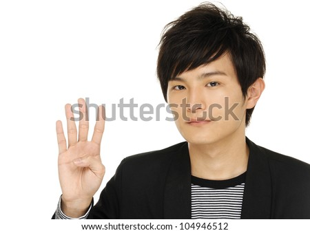 young asian man hold 4 fingers up - stock photo