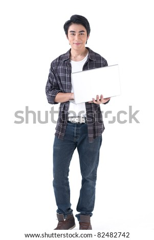 Young asian man holding laptop computer and work - stock photo