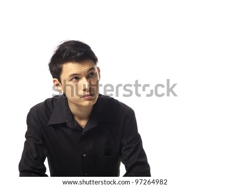 Young Asian Man looking up over white background