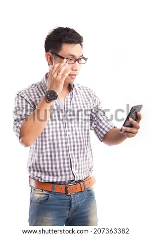 young asian man see something in his smart phone