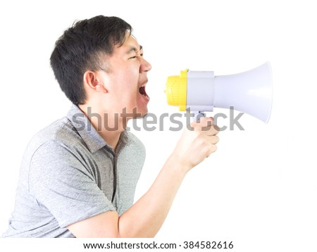 Young Asian man shouting with a megaphone isolated white background with clipping path - stock photo