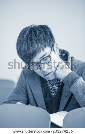 young asian man studying