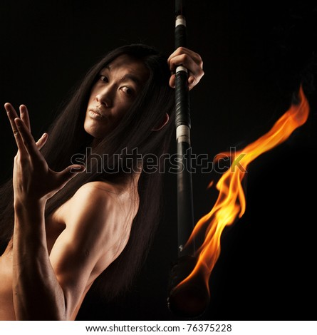 young asian man with fire show