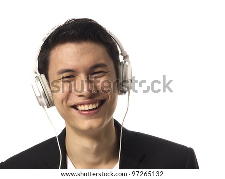 Young Asian Man with Headphones over white background - stock photo