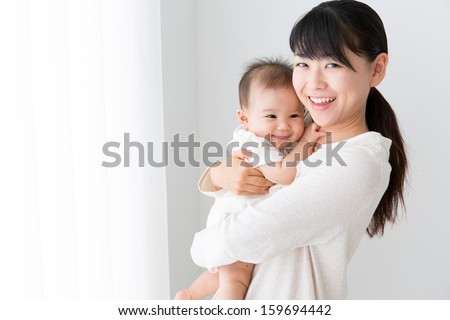 young asian mother and baby - stock photo