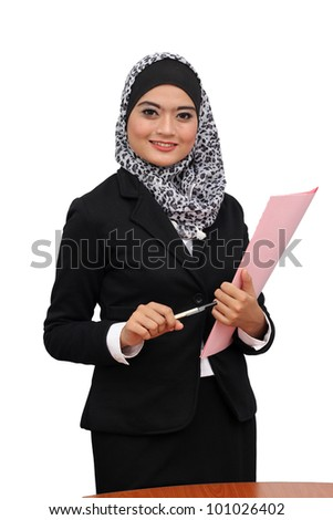Young asian muslim business woman smiling and holding file document