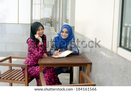 Young asian muslim woman in head scarf smile - stock photo