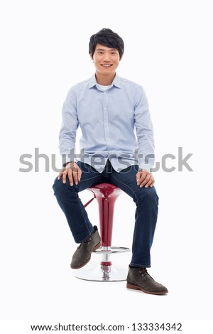 Young Asian person sitting on the chair isolated on white.