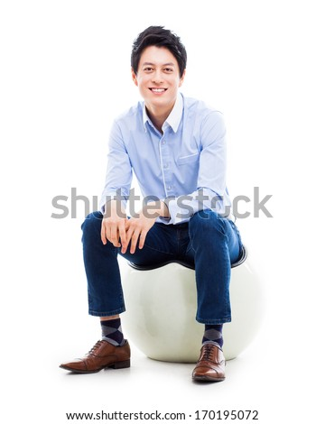 Young Asian person sitting on the chair isolated on white. - stock photo