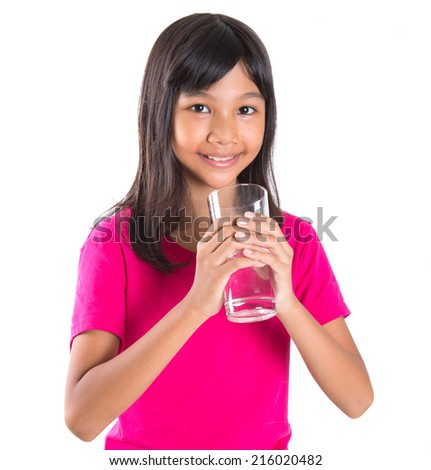 Young Asian preteen with a glass of water over white background