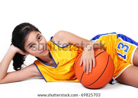 young asian pretty basketball player in white background. - stock photo