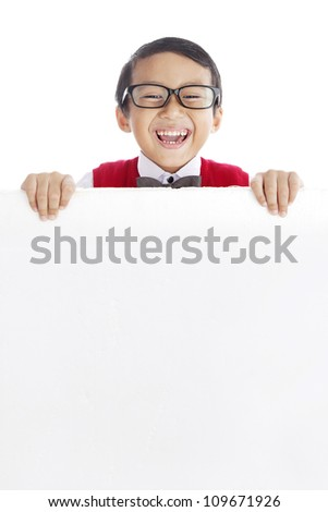 Young asian schoolboy showing blank copy space. shot in studio isolated on white