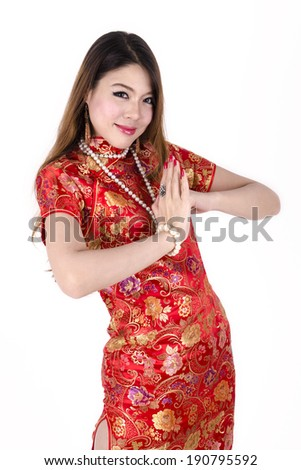 Young Asian Sexy Chinese female dress traditional cheongsam at Chinese New Year, isolated on white background.