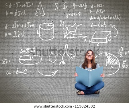 Young asian student girl reading the book. - stock photo
