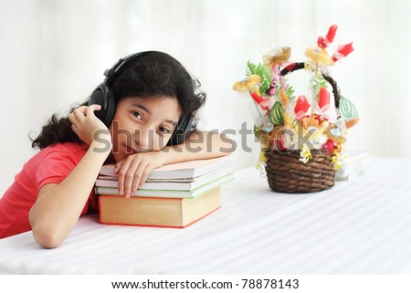Young asian student listening to music - stock photo