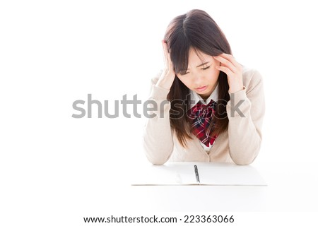 young asian student studying on white background - stock photo
