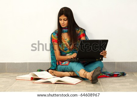 Young Asian student woman. Over white background - stock photo
