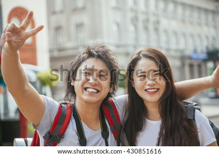Young Asian Tourists - stock photo