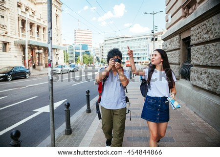 Young Asian Tourists Sightseeing And Taking A Photo - stock photo