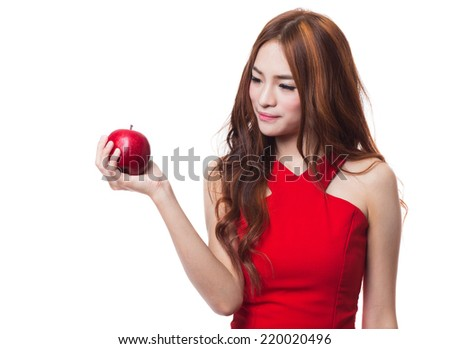 Young asian woman eating red apple on white background
