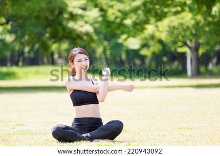 young asian woman exercising in the park - stock photo