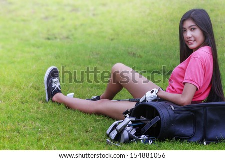 Young asian woman golf player